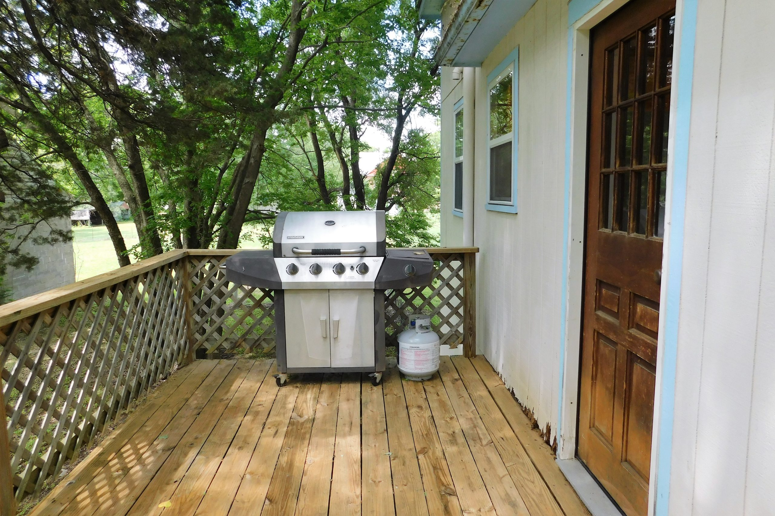 Shaded Deck with Gas Grill and Accessories